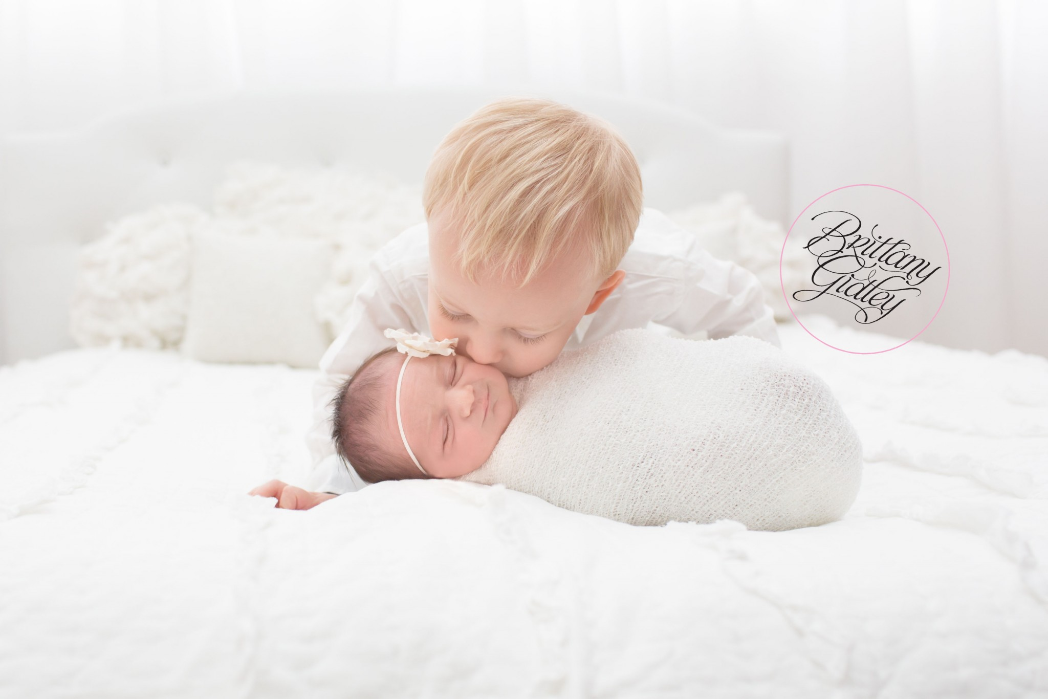 White Toddler Bed Newborn Family Photographer | Introducing Emily