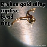 Hollow gold captive bead ring