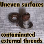 Contaminated externally threaded eyelet
