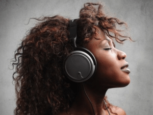 African American Woman Listening to Music