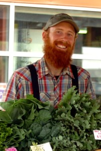 Bryan with kale at market