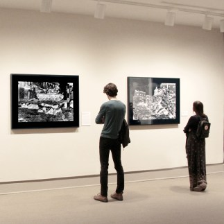 NMWA visitors study two of Rula Halawani's photographs in the She Who Tells a Story galleries