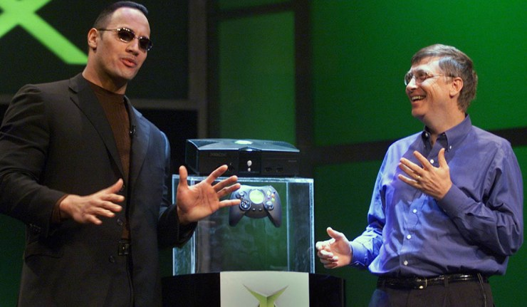"""LAS VEGAS, :  Bill Gates of Microsoft (R) speaks with World Wrestling Federation star """"The Rock"""" after Gates unveiled the new Xbox video game console at the Consumer Electronics Show in Las Vegas 06 January 2001. """"The Rock"""" will be featured in a video game when the Xbox launches in the fall of 2001.      AFP PHOTO/Jeff Christensen (Photo credit should read JEFF CHRISTENSEN/AFP/Getty Images)"""