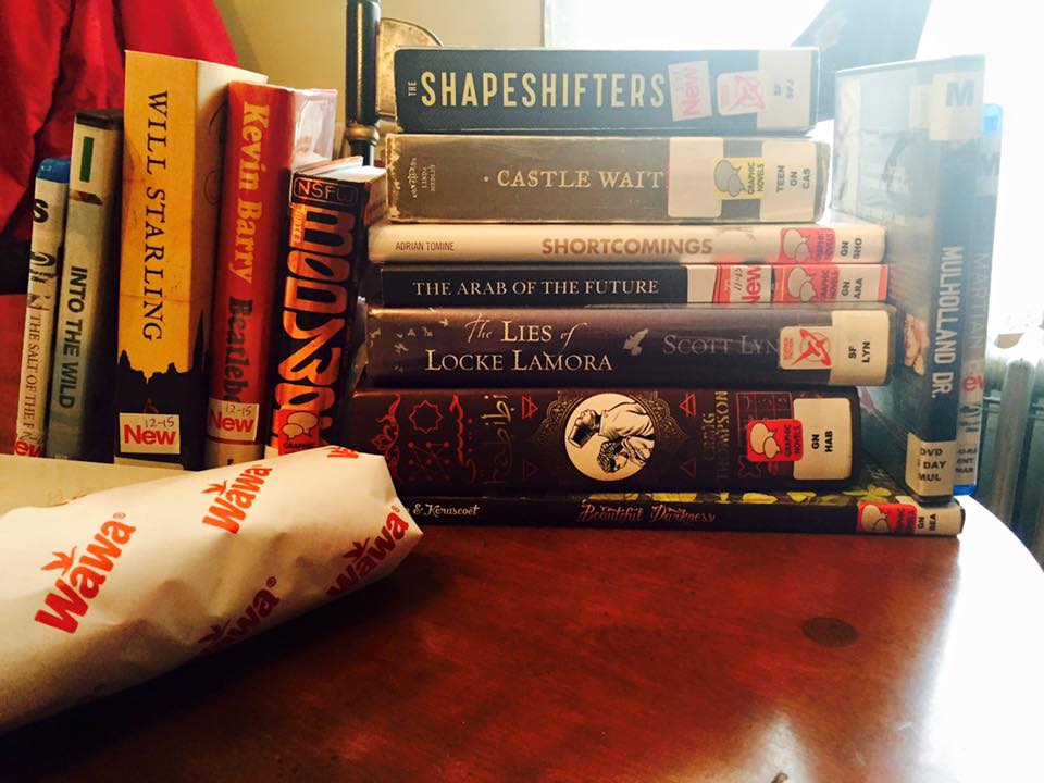 A typical library haul from a trip to the library when I'm hypomanic. (Apologies for the Wawa hoagie in the foreground.)