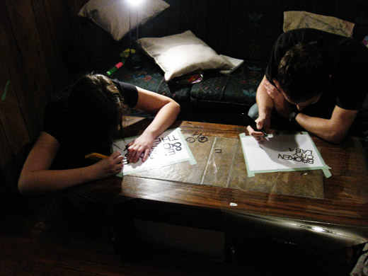 josh and michelle diligently working on the the stencils for tshirts