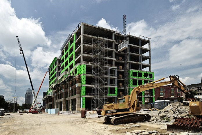 New building on Market Street tops out. (Courtesy U of L)