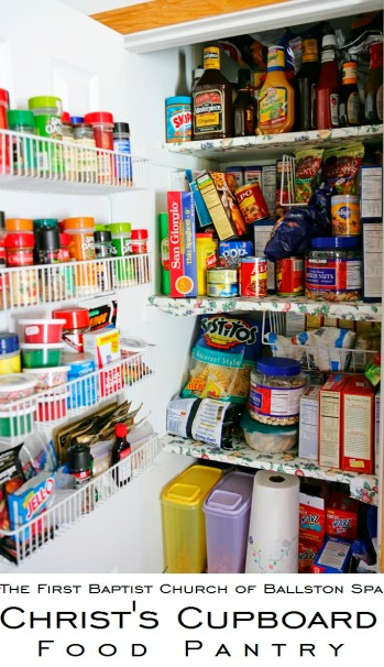 Full white pantry with wire baskets and floral shelves --- Image by © Royalty-Free/Corbis