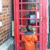 christmas present filled red phone box