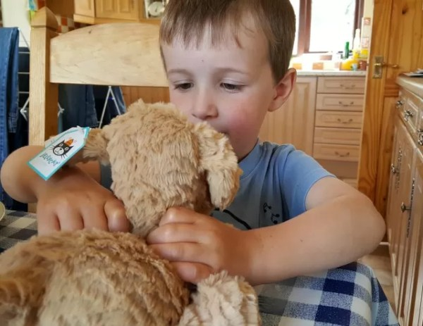 Meeting his new jellycat dog teddy