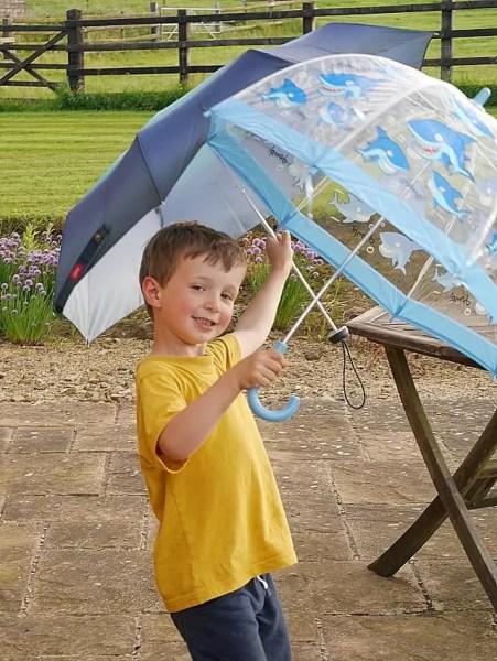 smiling with umbrellas
