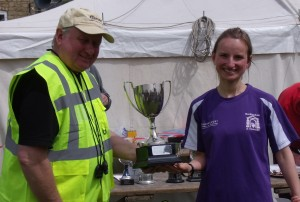 Emily receiving her trophy as first lady.