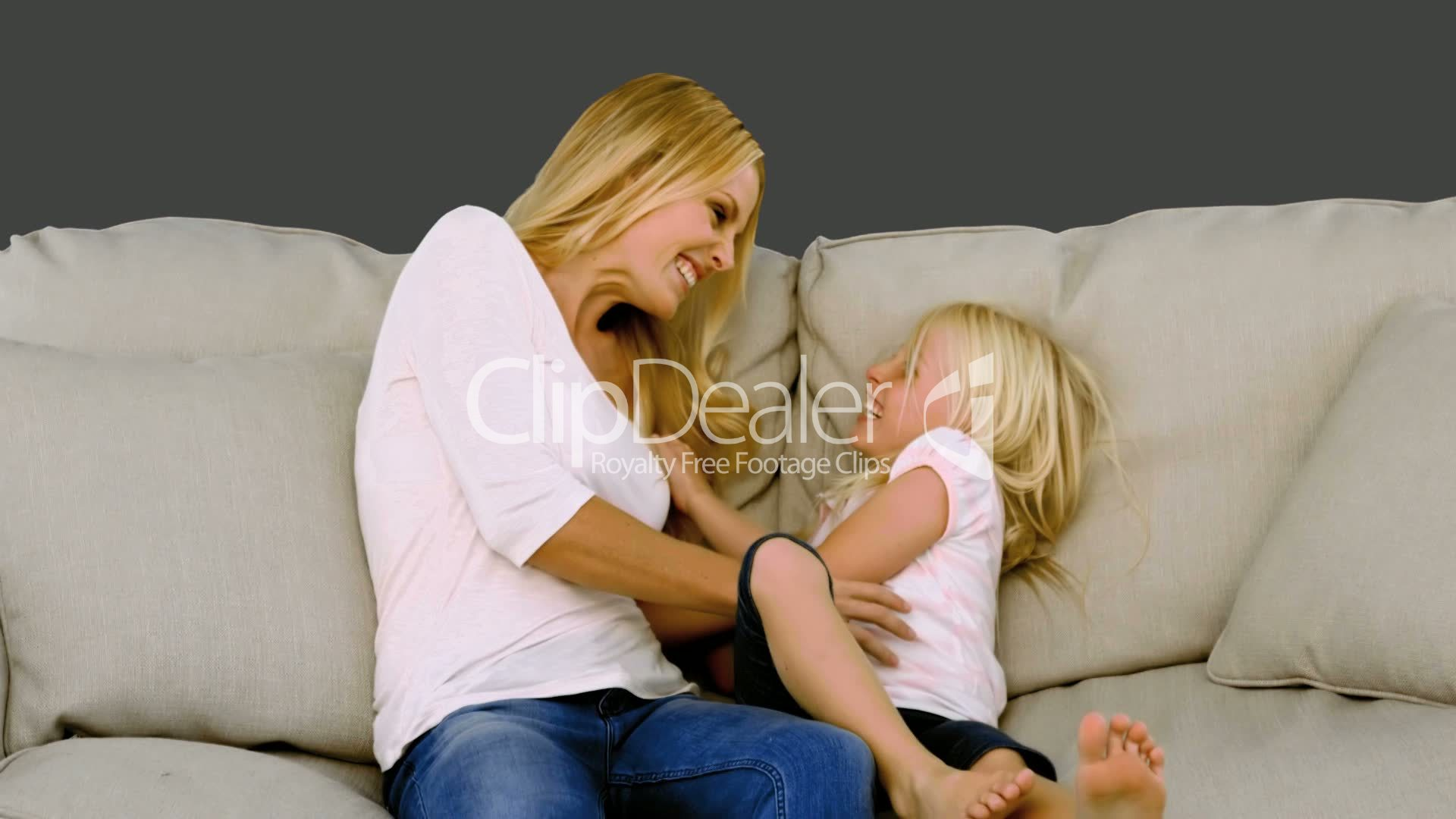 Social Sofa Mother Tickling Her Daughter On Sofa: Royalty-free Video