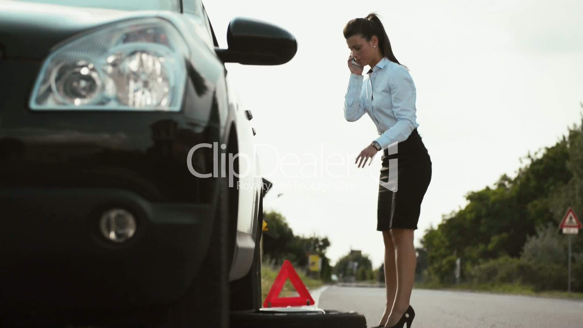 Stock Photo Free For Commercial Use Young Woman With Flat Car Tyre Calling Tow Truck Royalty