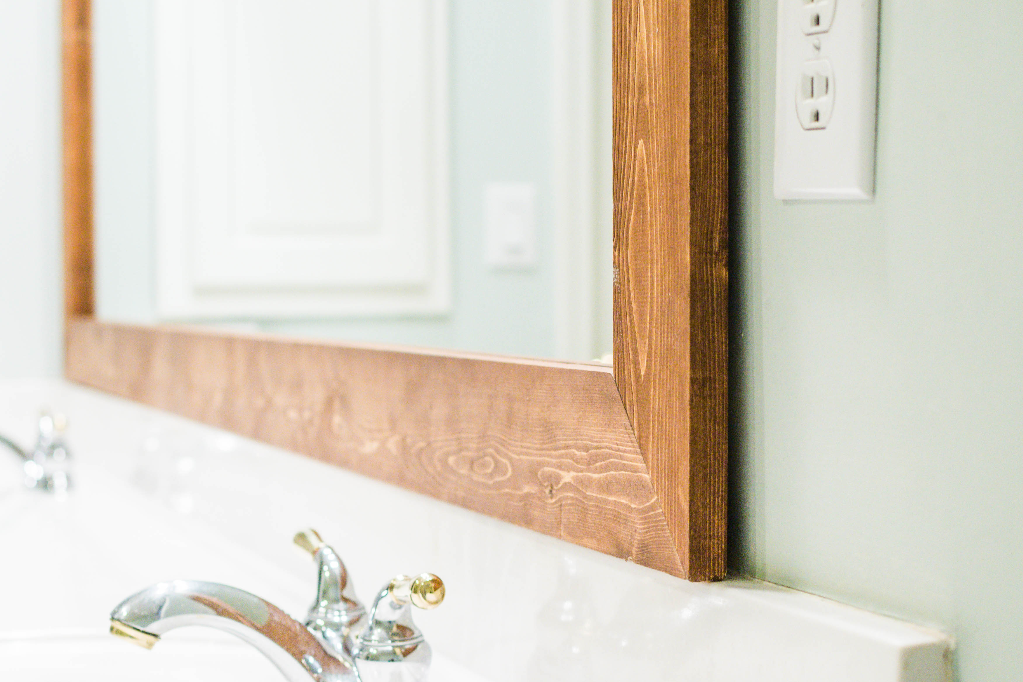 How To Frame Pictures How To Diy Upgrade Your Bathroom Mirror With A Stained Wood Frame