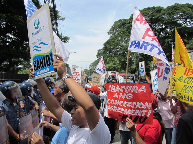 Calling Maynilad and Manila Water 'greedy,' protesters demanded the scrapping of concession agreement that 'legitimizes such greed.'  (Photo by M. Salamat / bulatlat.com)