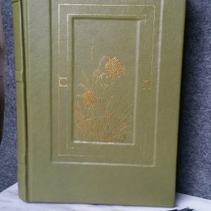A large, sage-green, desk journal in genuine leather with a golden image of snake's head fritillaries on the cover.
