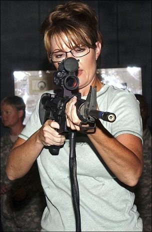 Sarah Palin, a life time NRA member (and recipient of large sums of their money), with assault rifle.