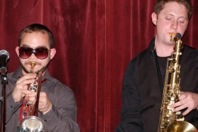Sanders opn the trumpet and Carroll on sax.