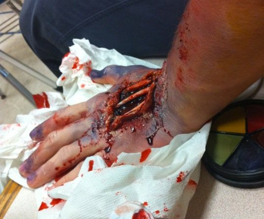 A BU student showcases the end result of the zombie makeup workshop for the Undead End.