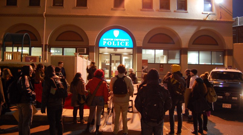 Protesters stopped in front of the BU Police Station demanding the end of police racism and sexism.