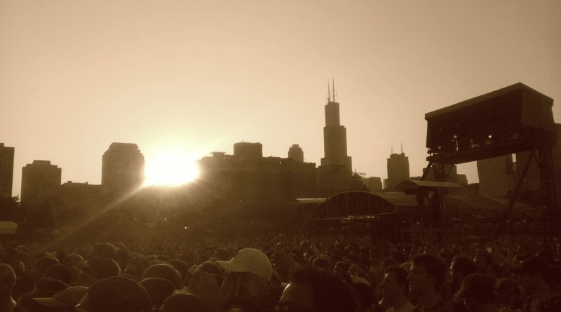The golden sun sets on the typically massive sea of people at Chicago's Lollapalooza music festival. | Photo courtesy of Raztaz42 via Wikimedia Commons