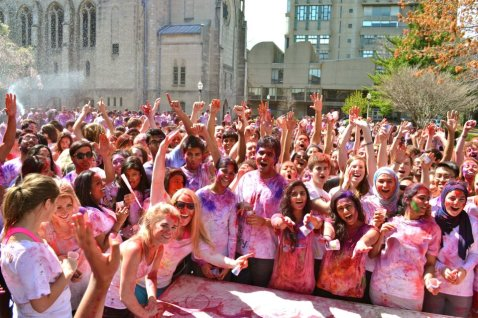 Students pose with arms raised in celebration of the Festival of Colors. | Photo courtesy of the BU Hindu Students Council