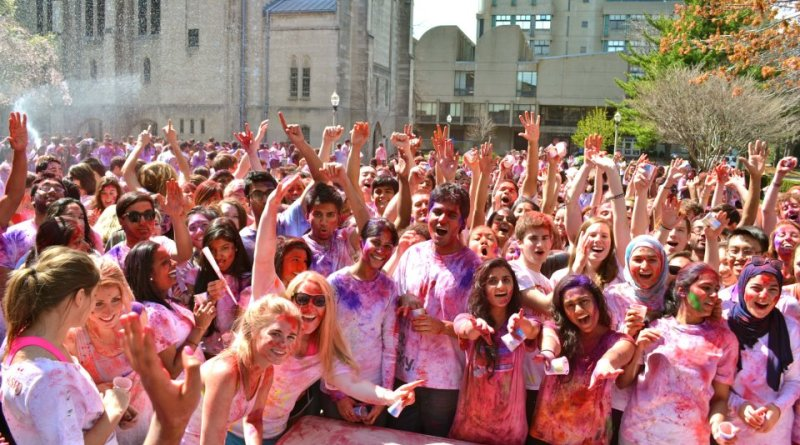 Students pose with arms raised in celebration of the Festival of Colors.   Photo courtesy of the BU Hindu Students Council