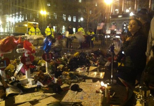 While some took to the Commons to celebrate last night, others gathered at the corner of Boylston to pay their respects. | Photo by Kelly Dickinson
