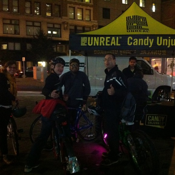 Friendly bikers posed with thumbs up as they grabbed a healthy alternative to traditional candy from the UNREAL Candy Unjunked booth - a company dedicated to serving all natural candy.