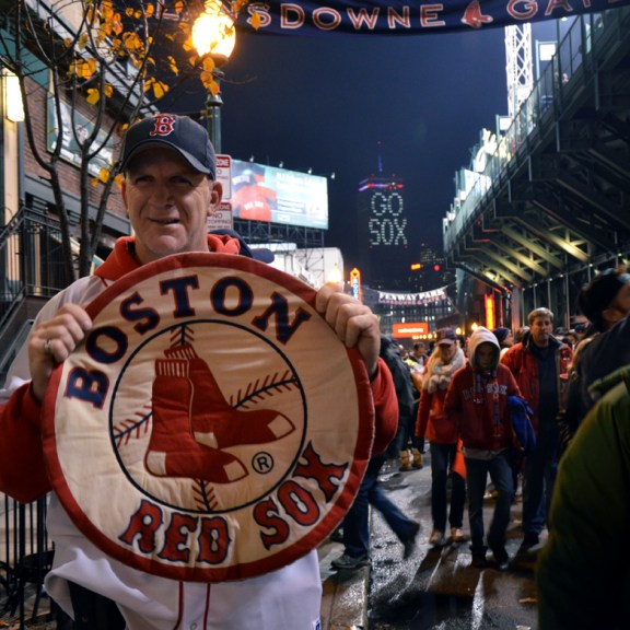Fan holds a home made Sox poster, cheering on their victory.