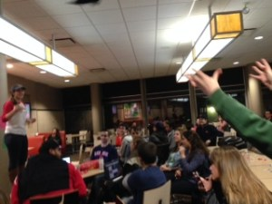 Leah Mackstutis throws a winner a BUTV10 t-shirt during a round of trivia | Photo courtesy Beth St. John