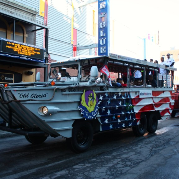 About a dozen Duck Boats carried players around Boston