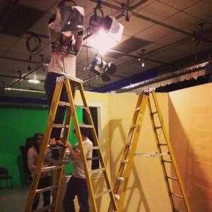 A production assistant helps with lighting| Photo courtesy of Stephanie Semet--Former Bay State PR Coordinator