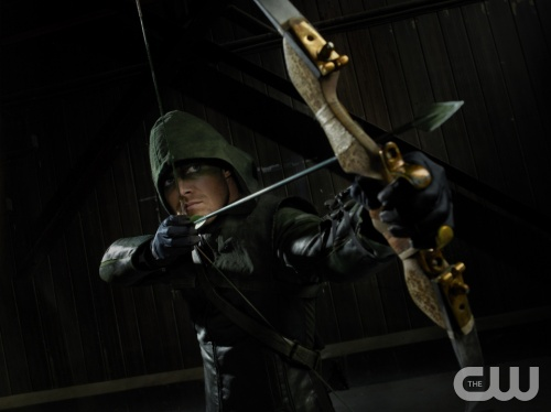 Stephen Amell poses in an early shot from the series | Promotional photo from http://www.cwtv.com/shows/arrow/