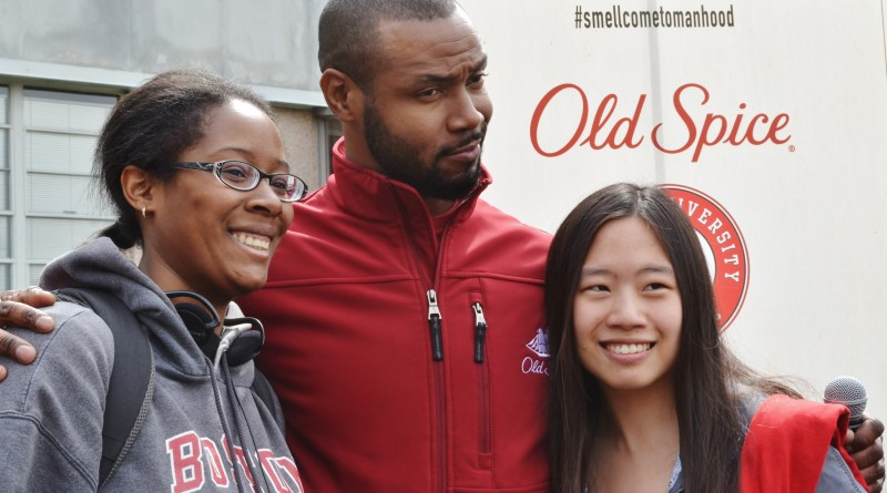 The Man Your Man Could Smell Like: The Quad's own Brie Garcia (left) gets her picture taken with the Old Spice guy | Photo by Alene Bouranova