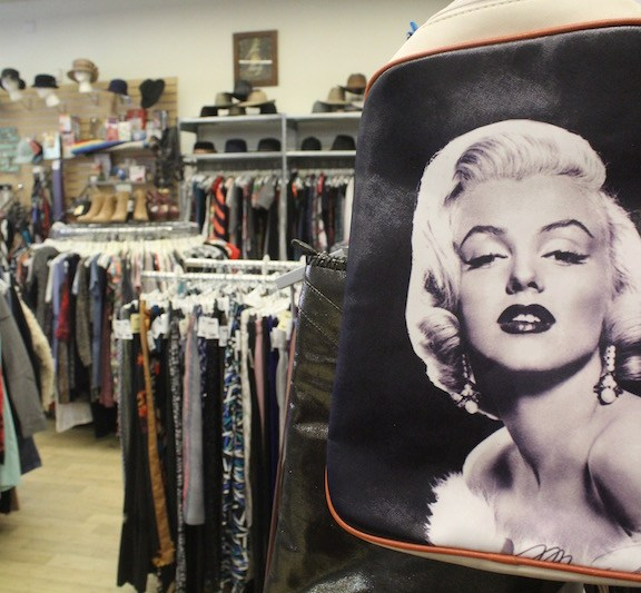 "A vintage backpack featuring a print of Marilyn Monroe had an opportunity for a second life at Buffalo Exchange. ""One of the biggest benefits of shopping resale is you're not adding to the demand for the production of more clothing which consumes natural resources. Instead, you're giving clothing a second life within your own community,"" Frederickson says."