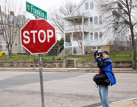 Touster photographs the street sign at Franklin Street, where Dzhokhar Tsarnaev was captured on April 19, 2013 and now where an American flag hangs as a reminder of the events that caused a frightening ripple across Watertown.