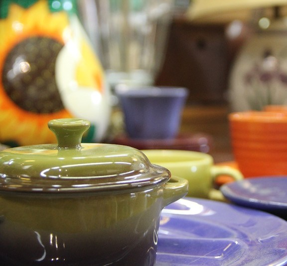 Unlike many consignment stores which focus on clothing, Rerun has a variety of products such as shoes, technology, accessories, furniture, and other household items like these colorful, gently-used ceramic plates and pots.