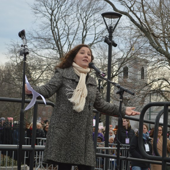"""Laura Rotolo from the ACLU said """"It's time up to stand up for each other, for our immigrant brothers and sisters. Let's get to work."""" Photo by Carolyn Komatsoulis"""