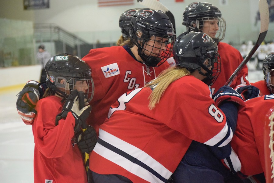 "RMU Sophomore Maggie LaGue involves one of the ""Little Sisters"" in the pregame."