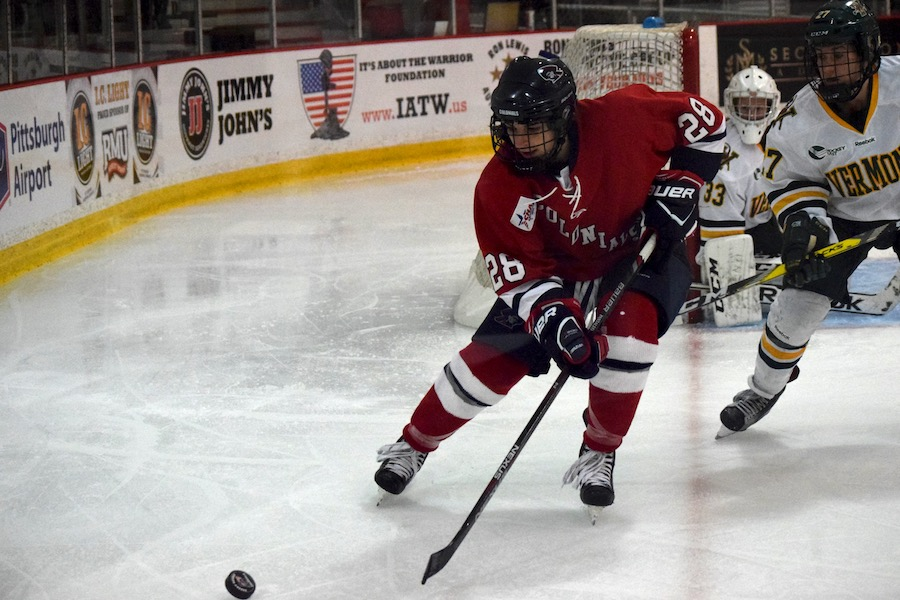 Junior Amanda Pantaleo retrieves a puck. -- BRIAN MITCHELL