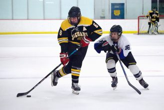 Thomas Jefferson forward Eddie Pazo (6) carries the puck against Hempfield forward Nick Wast (16) in a game at Kirk Nevin Arena on Thursday, Jan. 14, 2021. -- BRIAN MITCHELL