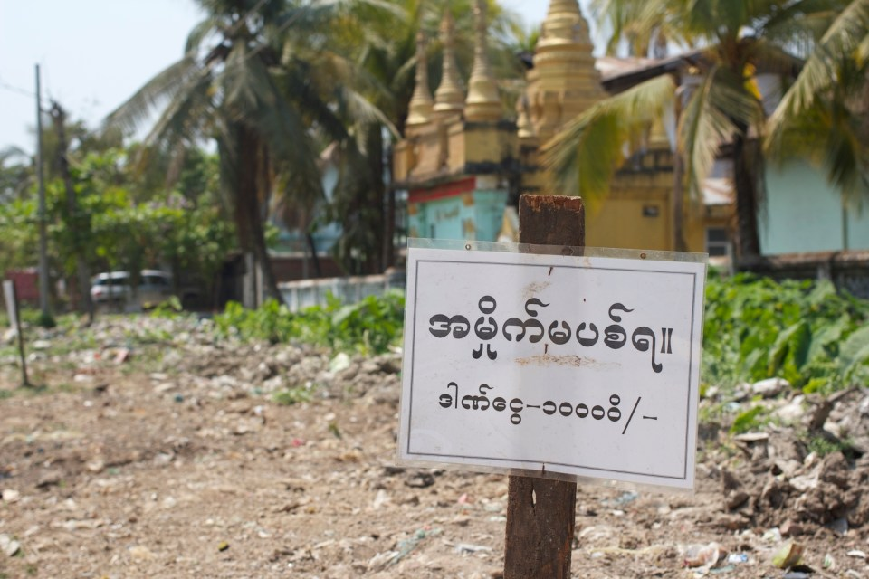 This, one of the most entertaining signs in our neighborhood, threatens a 10,000 kyat fine to those who litter.