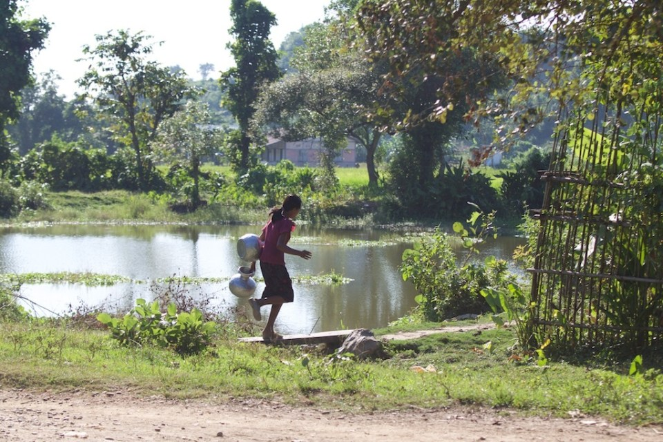 Fetching water. A lot of families in Rakhine state still collect water at a local well.