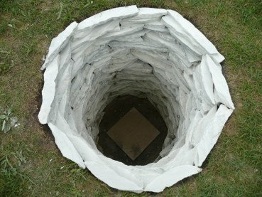 Cecelia Kane, Mother Hole, stacked marble shards in a hole.