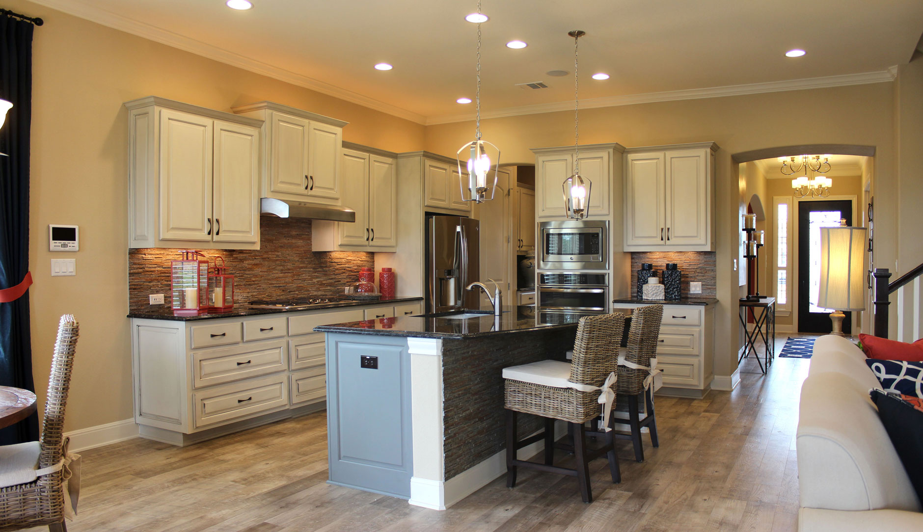 choose flooring compliments cabinet color ash kitchen cabinets Kitchen cabinet 2 by Burrows Cabinets at Travisso with painted cabinets in Bone with black glaze