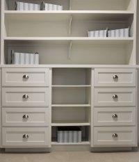 Closet storage with white shaker style drawer fronts