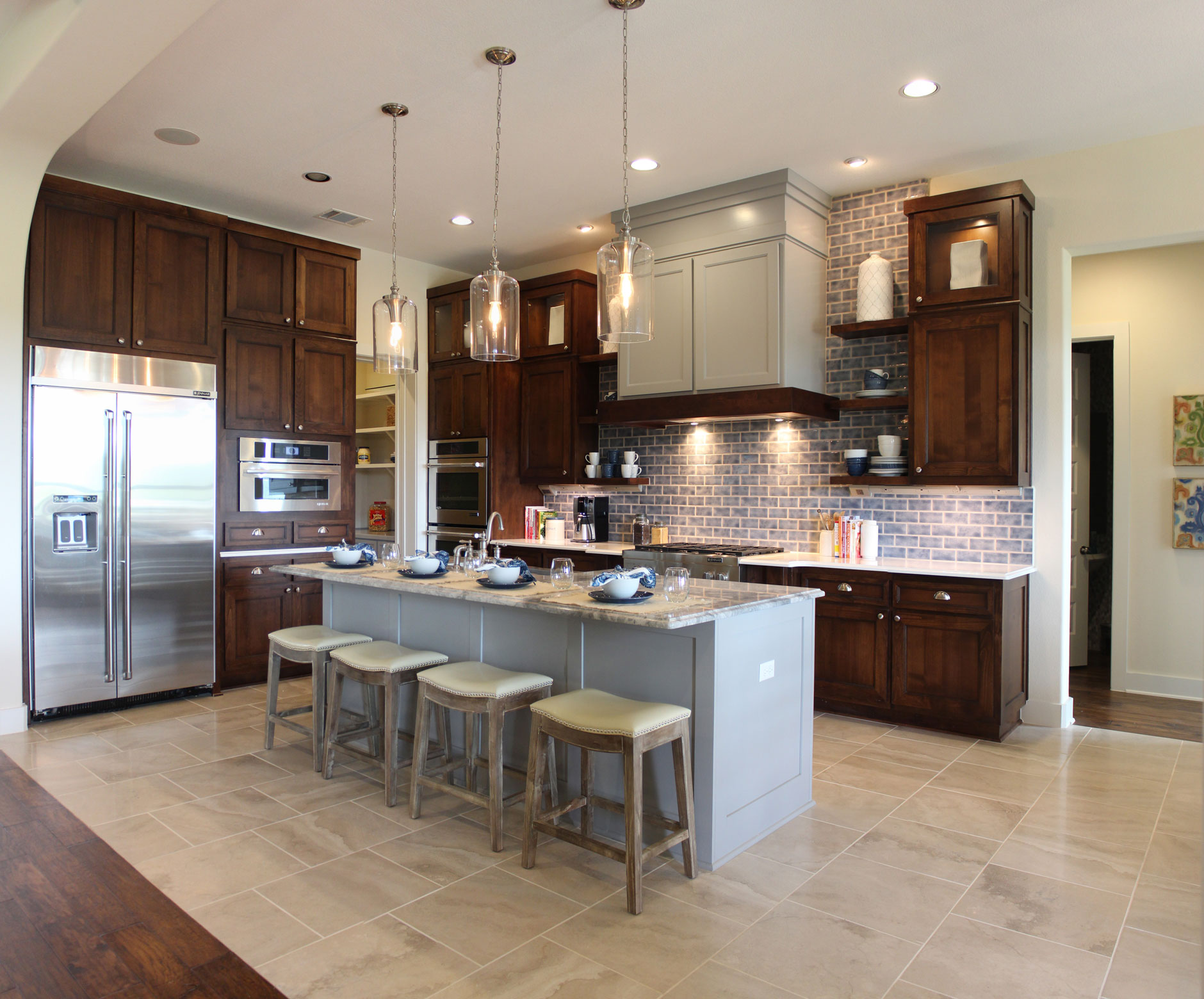choose flooring compliments cabinet color ash kitchen cabinets Burrows Cabinets kitchen cabinets in stained perimeter cabinets and gray island Craftsman range hood and