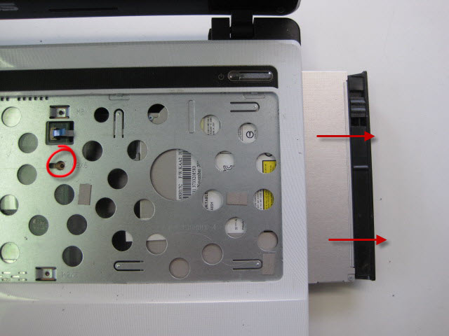 Remove the screw circled and remove the DVD drive as shown.
