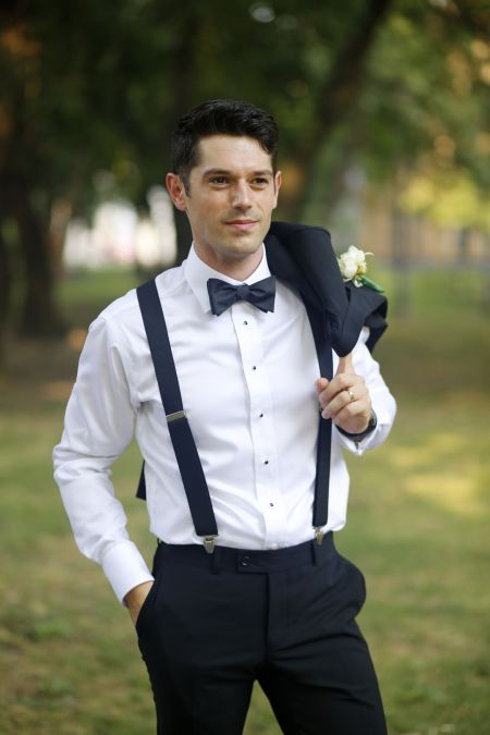 Elegant groom in the park posing